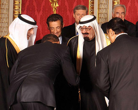 Obama bows in submission